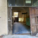 The entrance to an abandoned building at some military ruins near Dębina, Poland.
