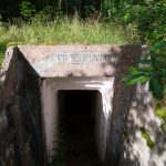 Bunker entrance at military ruins near Dębina, Poland.