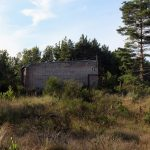 An abandoned building at military ruins near Dębina, Poland.