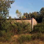 An abandoned building block at military ruins in the woods near Dębina, Poland.