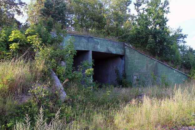 The entrance to a bunker structure at military ruins near Dębina, Poland.