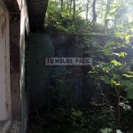 """A sign translated """"Smoking area"""" outside some military ruins near Dębina, Poland."""