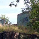 A wall with graffiti at some military ruins near Dębina, Poland.