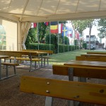 Tables and flags at the Fusina campsite
