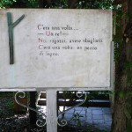 "View of the sign ""C'era una volta"" (""Once upon a time"") at the village entrance in Pinocchio Park, Collodi, Tuscany"
